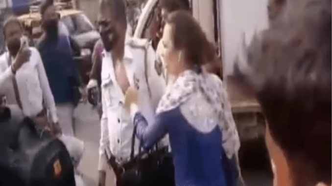 Mumbai-Two-persons-including-a-woman-who-was-seen-thrashing-a-police-personnel-on-duty-&-misbehaving-with-him-on-Kalbadevi-Road-in-a-viral-video-have-been-arrested
